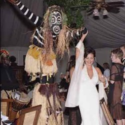 Bride with Mocko Jumbie Stiltwalker (1)